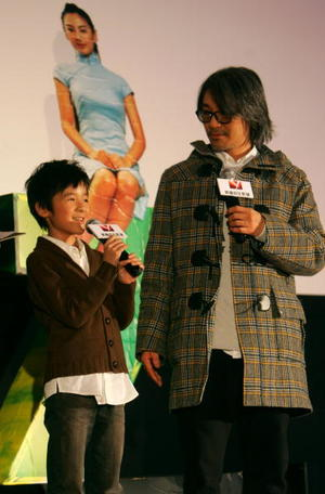 "Actors Xu Jiao and Stephen Chow at a press conference in Beijing, China, to promote ""CJ7."""