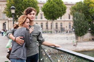 "Miley Cyrus as Lola and Douglas Booth as Kyle in ""LOL."""