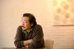 "Director Hong Sang-soo on the set of ""In Another Country."""