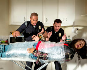 """A scene from """"Let's Be Cops."""""""