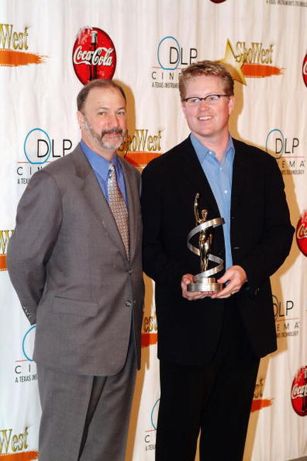 Rich Fay and Andrew Stanton at the final night banquet for ShoWest 2004.