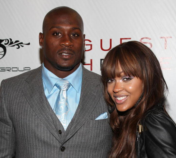 Football player Thomas Jones and Meagan Good at the Thomas Jones' birthday party.