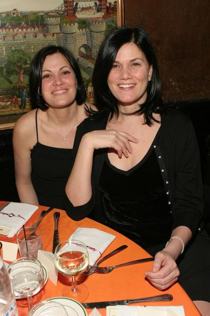Linda Fiorentino and guest at the Entertainment Weekly's Oscar Viewing Party.