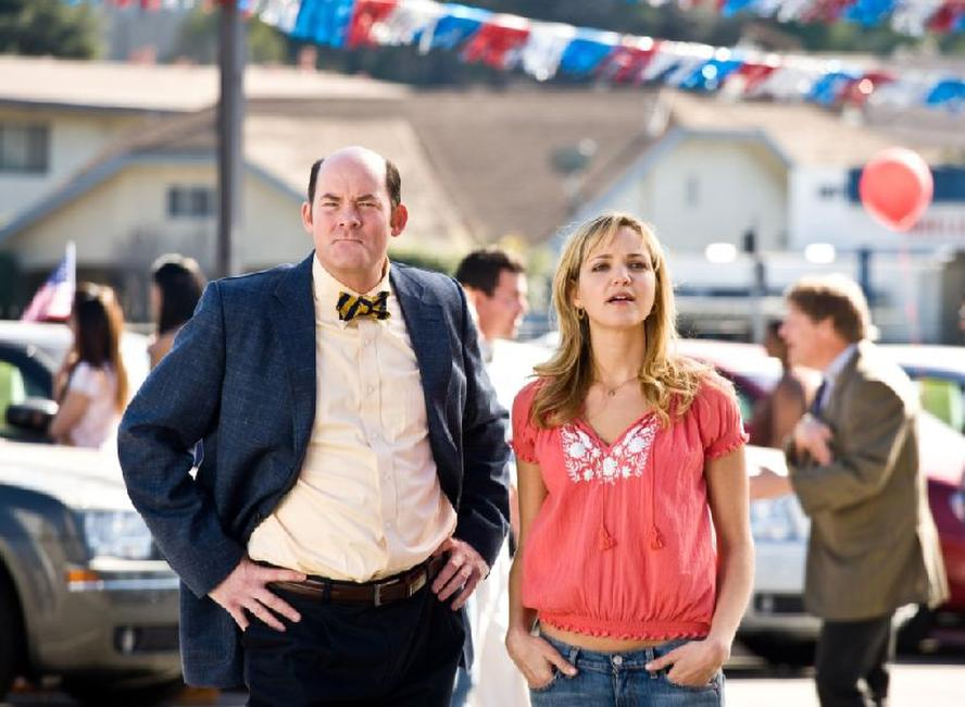 David Koechner as Brent Gage and Jordana Spiro as Ivy Selleck in