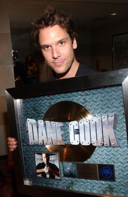 RIAA & Comedy Central present Dane Cook with gold record.
