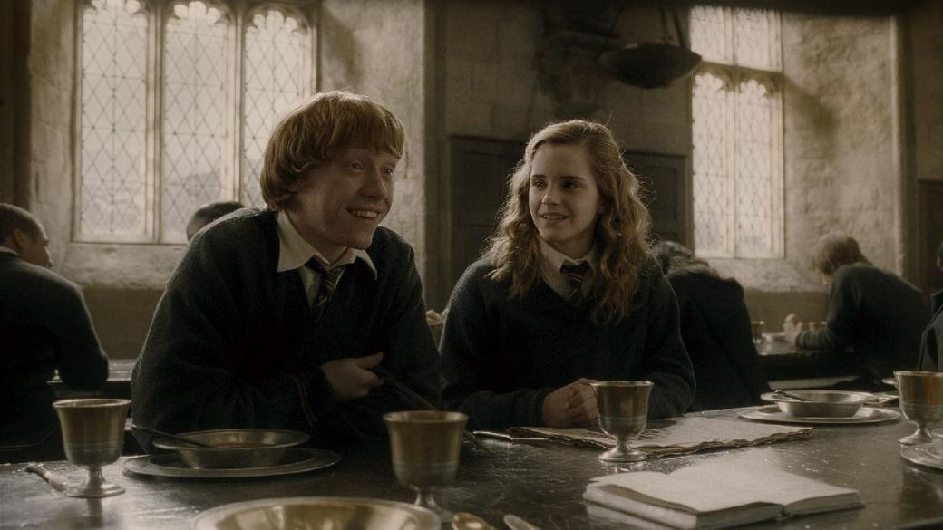 Rupert Grint as Ron Weasley and Emma Watson as Hermione Granger in