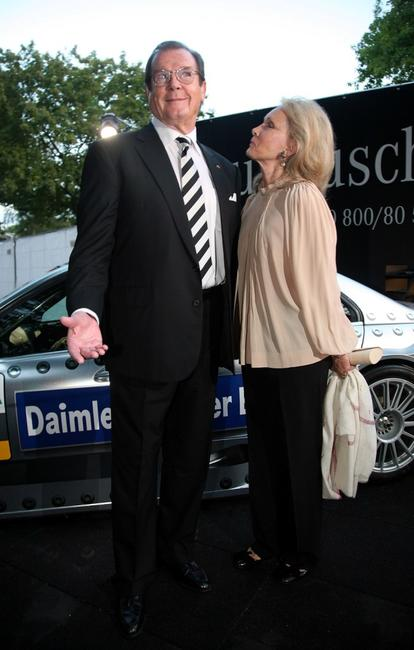 Roger Moore and wife Christina Tholstrup at the DTM Come Together party.
