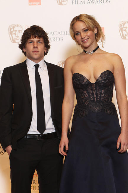 Jesse Eisenberg and Jennifer Lawrence at the Orange British Academy Film Awards 2011 in England.