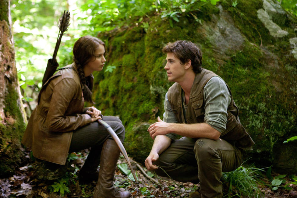Jennifer Lawrence as Katniss and Liam Hemsworth as Gale in