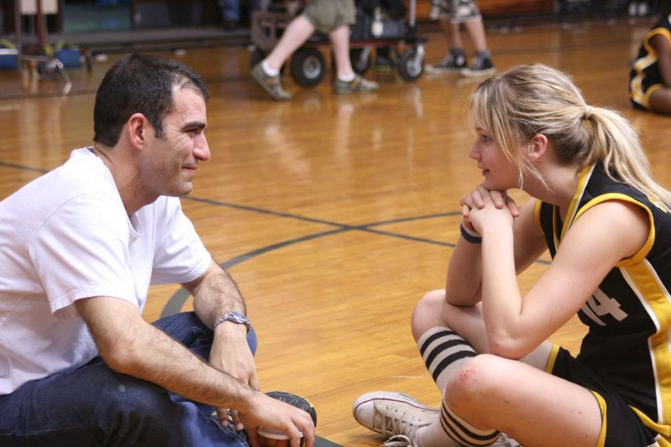 Producer Peter Quartaroli and Jennifer Lawrence on the set of