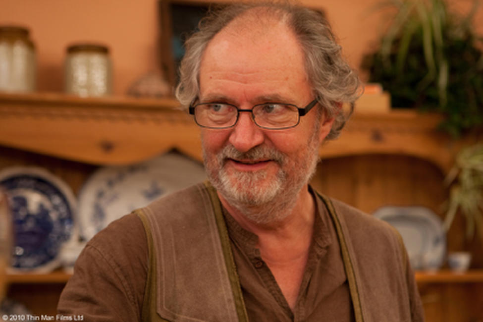 Jim Broadbent as Tom in