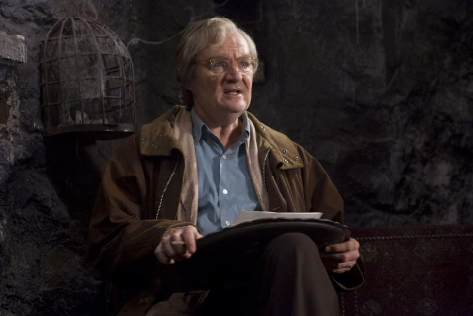 Jim Broadbent as Fenoglio in