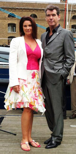 Pierce Brosnan and his wife, Keely Shaye Smith, at a media conference to launch the whale research ship 'Song of the Whale' at St. Katherine Docks.
