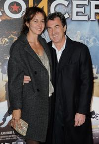 Francois Cluzet and Guest at the premiere of