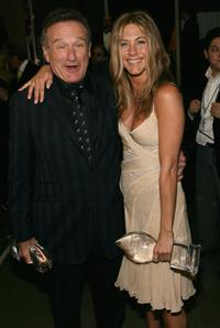 Jennifer Aniston and Robin Williams at the press room during the 33rd Annual People's Choice Awards.