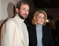 Stefano Pilati and Catherine Deneuve at the opening of a new YSL store.