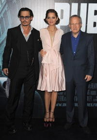 Johnny Depp, Marion Cotillard and Michael Mann at the premiere of