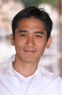 "Tony Leung at a photocall for ""In the Mood for Love"" in Cannes, France."