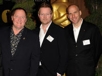 Producer John Lasseter, Andrew Stanton and Producer Michael Hirsh at the 83rd Academy Awards in California.