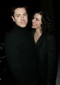 Ron Eldard and his wife Julianna Margulies at the Narciso Rodriguez Fall/Winter 2003 Collection fashion show during Mercedes-Benz Fashion Week.
