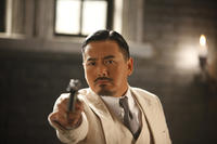 Yun-Fat Chow as Master Huang in ``Let the Bullets Fly.''