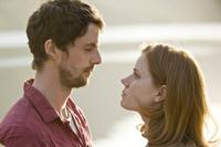 Matthew Goode as Declan and Amy Adams as Anna in