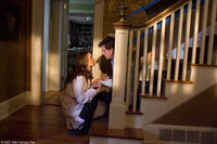 Nick Hume (Kevin Bacon) is consoled by his wife (Kelly Preston) in