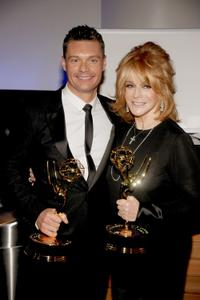 Ryan Seacrest and Ann-Margret at the 62nd Primetime Creative Arts Emmy Awards.