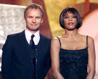 Whitney Houston and Guest at the 41st Annual Grammy Awards in California.