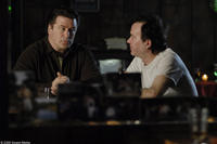 Alec Baldwin as Mickey Bartlett and Timothy Hutton as Charlie Bragg in