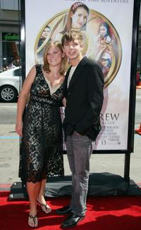 Max Thieriot and guest at the premiere of