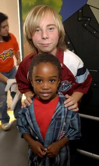 Steven Anthony Lawrence and Khamani Griffin at the Disney's Toontown Online Takes Hollywood celebrity charity video game event.