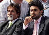 Amitabh Bachchan and Abhishek Bachchan at the French Tennis Open quarter final match between Swiss player Roger Federer and Spanish Tommy Robredo.