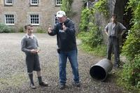 Alex Etel, director Jay Russell and Ben Chaplin on the set of