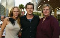 Charlie, Jason London and Guest at the premiere of