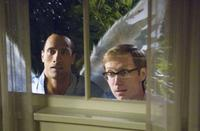 Dwayne Johnson as Derek Thompson and Stephen Merchant as Tracy in
