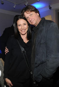 Mimi Rogers and Don McManus at the dinner party of