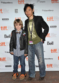 Ty Simpkins and writer/director James Wan at the premiere of