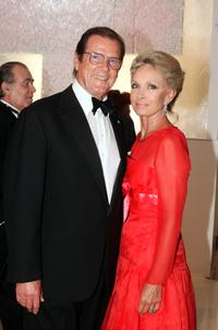 Roger Moore with his wife Christina Tholstrup at the 57th Red Cross Ball.