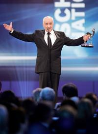 Armin Mueller-Stahl at the annual Bambi Awards, winner in the category 'Acting', accepts his award.
