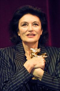 Anouk Aimee at the Berlinale Film Festival, clutches her Golden Bear Award for lifetime achievement.