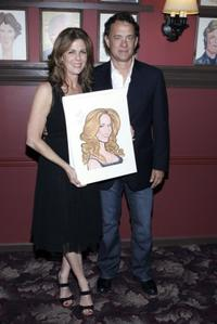 Rita Wilson and Tom Hanks pose with a caricature made in her honor for her Broadway debut in