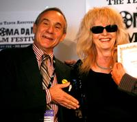 Lloyd Kaufman and Penelope Spheeris at the 2008 AFM Troma Press Conference.