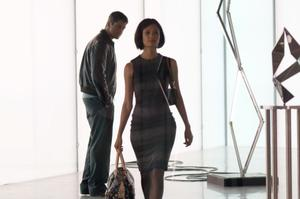 "Gerard Butler as One Two and Thandie Newton as Stella in ""RocknRolla."""