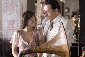 "Gong Li as Anna Lan-Ting and John Cusack as Paul Soames in ""Shanghai."""