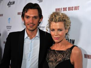 "Lukas Haas and Kim Basinger at the California premiere of ""While She Was Out."""