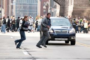 "Elizabeth Banks as Lara Brennan and Russell Crowe as John Brennan in ""The Next Three Days."""