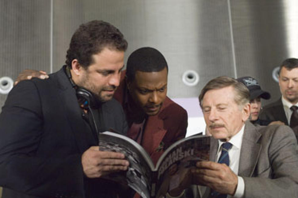 Director Brett Ratner, Chris Tucker and director Roman Polanski on the set of