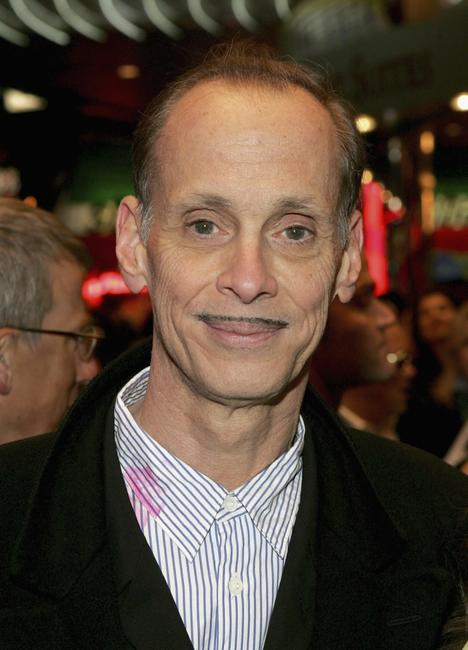 John Waters at the opening night for