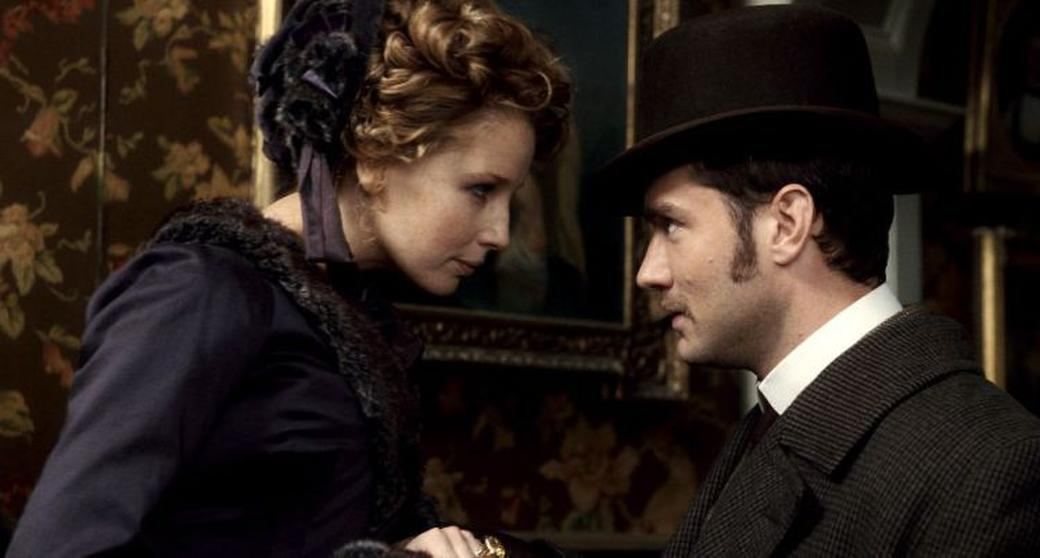Kelly Reilly as Mary Morstan and Jude Law as Dr. John Watson in